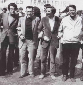 Manifestation du 1er mai 1971, Paris. De gauche à droite : Alain Krivine, Michel Rocard, Gilbert Marquis, Michel Fiant.